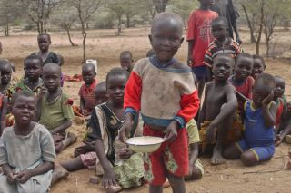 Children in East Africa receiving food aid