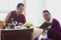 Lama Dondrup Dorje Rinpoche showing HH Karma Kuchen Rinpoche content on the iPad